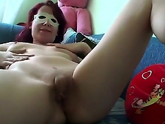 Naughty redhead surprises us with a private deprecate video in sexy mask