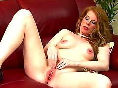 Sexy sensational red head enjoys her own host as she fingers her cunt passionately