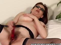 Mature redhead enervating nothing but the brush shades and stockings plays with the brush aged pussy