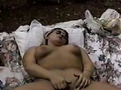 Curvy girl on blanket outdoors fingers pussy