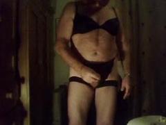 Chubby crossdresser jerks off into condom