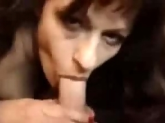 Horny brunette mature sucks
