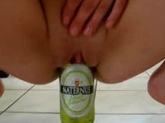 Amateur fucks a beer bottle on every side kitchen